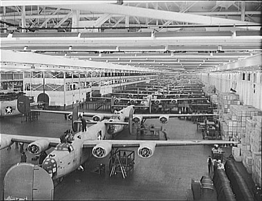 View of part of the B-24 line at the Willow Run Plant in Michigan. The plant housed 67 acres of land under a single roof, and a B-24 Liberator bomber (1.55 million parts each) came off the line every 63 minutes.